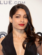 Freida Pinto wore her hair in a tumble of waves past her shoulder during the Elton John AIDS Foundation Oscar-viewing party.