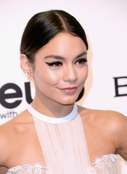 Vanessa Hudgens styled her hair into a slicked-down, center-parted bun for the Elton John AIDS Foundation Oscar-viewing party.