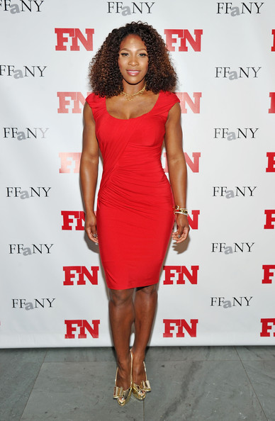 Serena Williams topped off her ladylike red dress with metallic gold pumps complete with bold bow accents.
