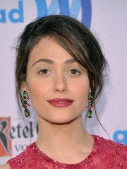 Emmy Rossum swiped on some raspberry lipstick to match her outfit.