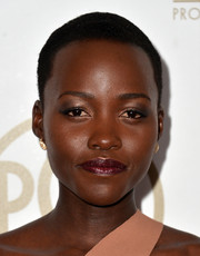 Lupita Nyong'o swiped on some berry lipstick and neutral eyeshadow for a subdued beauty look during the Producers Guild of America Awards.