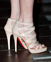 Julianne showed off these nude zip up sandals at the Santa Barbara Film Festival. Cute shoes, but she probably should have opted to polish her toes. Just a thought.