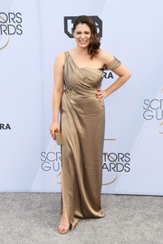 Rachel Bloom polished off her monochromatic look with gold platforms and a matching clutch.