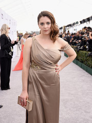Rachel Bloom paired a gold Jimmy Choo box clutch with a matching off-the-shoulder dress for the 2019 SAG Awards.