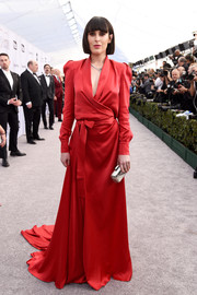 Rumer Willis cut a sophisticated figure in a red Ong-Oaj Pairam wrap gown with a floor-sweeping hem at the 2019 SAG Awards.