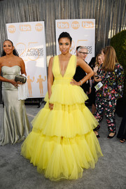 Susan Kelechi Watson gave us Belle vibes in a voluminous yellow gown by Christian Siriano at the 2019 SAG Awards.