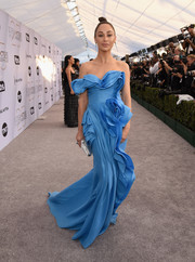 Cara Santana was a work of art in a sculptural blue off-one-shoulder gown by Ermanno Scervino that she paired with an Atelier Swarovski clutch and jewels at the 2019 SAG Awards.