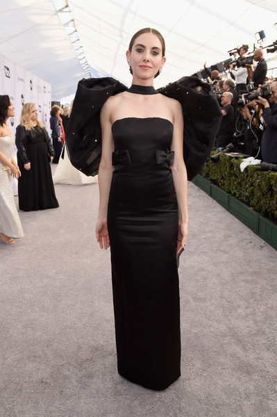 Alison Brie dolled up in a strapless black Miu Miu gown with a matching giant bow at the back for the 2019 SAG Awards.