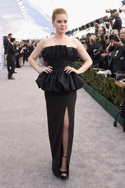 Amy Adams glammed up in a strapless black Celine gown with a ruffle neckline and a bubble peplum waist for the 2019 SAG Awards.