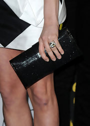 Brittany Snow teamed her graphic mini dress with a sleek black Snake Fringe clutch.