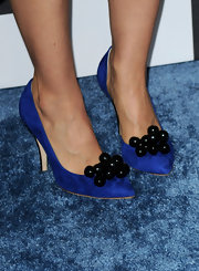 Always one to wear something unexpected, Mena showed off these cute blue suede heels at the independent spirit awards. The heels featured black ornaments at the toe which gave them a different look.