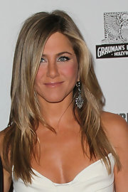 Jennifer Aniston added major glitter with a pair diamond chandelier earrings by Fred Leighton.