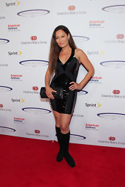 Tia Carrere's black knee-high boots and LBD combo were a perfect mix of sexy and edgy.