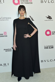 Nicole Trunfio went goth in a caped black gown for the Elton John AIDS Foundation Oscar-viewing party.