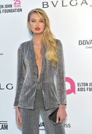 Romee Strijd teamed a gunmetal clutch with a silver suit for the Elton John AIDS Foundation Oscar-viewing party.