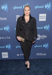 Meghan McCain styled her all-black outfit with a striped hard-case clutch by Jimmy Choo.