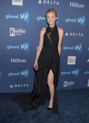 Portia de Rossi wowed at the GLAAD Media Awards in a floor-sweeing black Donna Karan gown with a sheer panel, architectural detailing, and a thigh-high slit.