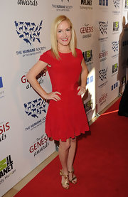 Angela Kinsey wore this red fit-and-flare dress to the Genesis Awards.