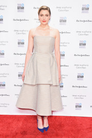 Greta Gerwig injected some color with a pair of blue Christian Louboutin pumps.