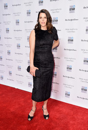 Neve Campbell chose a pair of black peep-toes with bedazzled ankle straps to finish off her outfit.