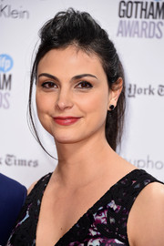 Morena Baccarin attended the Gotham Independent Film Awards sporting a messy ponytail with a pompadour top.