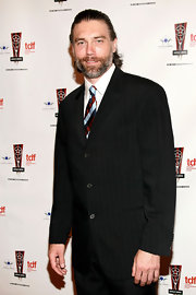 Anson Mount attended the Annual Lucille Lortel Awards in a handsome pinstripe black blazer in a relaxed fit.