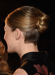 Rosamund Pike pulled her hair back into a chic bun for the Palm Springs International Film Festival Awards.