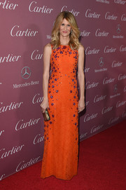 Laura Dern looked effervescent at the Palm Springs International Film Festival Awards in a bright orange Matthew Williamson gown encrusted with purple flower beads.