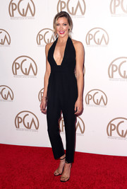 Katie Cassidy arrived at the 26th Annual Producers Guild Of America Awards in a sexy jumpsuit with a deep plunge neckline.