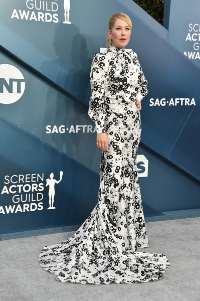 Christina Applegate kept it demure in a long-sleeve black-and-white floral gown with a long train at the 2020 SAG Awards.
