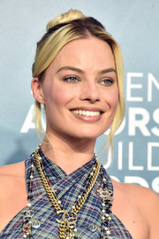 Margot Robbie opted for a casual top knot when she attended the 2020 SAG Awards.