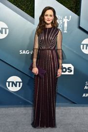 Alexis Bledel topped off her dress with a matching envelope clutch.