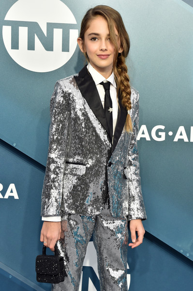 Julia Butters paired a beaded black purse with a silver sequined pantsuit for the 2020 SAG Awards.