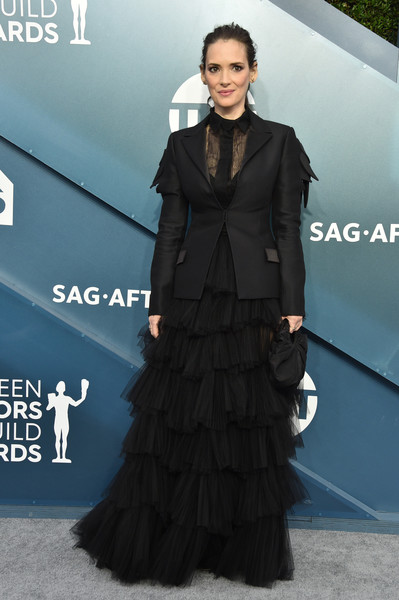 Winona Ryder toned down the feminine appeal with a fitted black blazer.