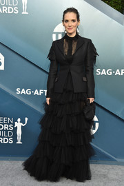 Winona Ryder dolled up in a tiered black tulle skirt and a matching blouse for the 2020 SAG Awards.