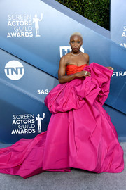 Cynthia Erivo brought her signature bold style to the 2020 SAG Awards with this voluminous fuchsia and red strapless gown by Schiaparelli Couture.
