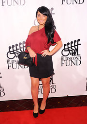 Angelina Pivarnick looked funky at the Sports Legends dinner in her black mini and red top.