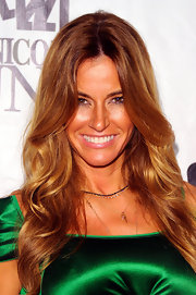 Kelly Bensimon wore her tresses in long, sexy waves at the 26th annual sports legends dinner. To try her look at home, curl one-inch sections of hair with a large-barreled curling iron, making sure to curl each piece in the same direction. Next, lightly comb through hair to soften curls and finish with a product like ALTERNA Caviar Anti-Aging Rapid Repair Spray for added shine.