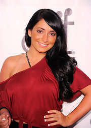 Angelina Pivarnick wore her long, lovely lock in soft waves to the 26th Annual sports legends dinner.  To try her look, set dry hair in hot rollers. To relax the curls slightly, brush tresses with a natural bristle brush, then make a deep side part. Smooth the hair on the top of the head, sweep bangs over and tousle ends lightly.