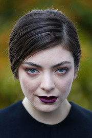 Lorde looked edgy with her dark purple lipstick.