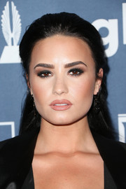 Demi Lovato played up her eyes with lots of smoky makeup.