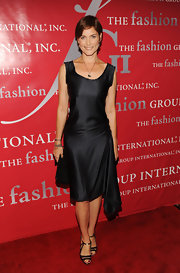 Carey donned strappy pewter heels. The shoes were the perfect finishing touch to her asymmetric LBD.