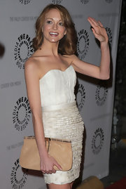 Actress Jayme Mays looked darling in her white strapless dress, which featured a fringe hemline. She competed her look with a beige zipper clutch.