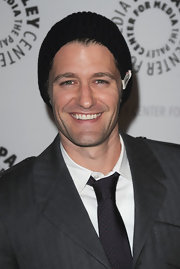 Matthew Morrison stayed warm on the red carpet in a black knit beanie.