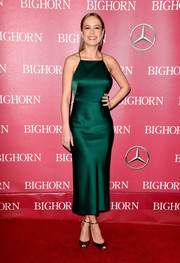 Brie Larson paired her dress with bronze ankle-strap peep-toes by Brian Atwood.