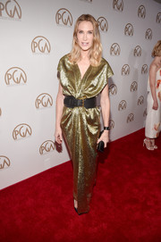 Kelly Lynch brought plenty of sparkle to the Producers Guild Awards red carpet with this draped gold evening dress.