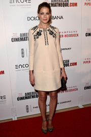 Michelle Monaghan went for a retro vibe at the American Cinematheque Award in a long-sleeve nude Miu Miu shift with an embellished neckline.
