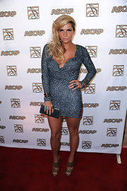 Kesha donned a sparkling long-sleeved cocktail dress for the ASCAP Pop Music Awards.