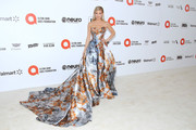AnnaLynne McCord made a grand entrance in a strapless floral ballgown by Mark Zunino at the 2020 Elton John AIDS Foundation Oscar-viewing party.