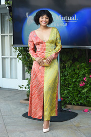 Kiersey Clemons paired her gorgeous dress with a mirrored gold clutch.